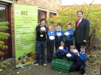 Kenneth Cheung with headteacher Len Guest (right) and pupils at Moorside Primary School
