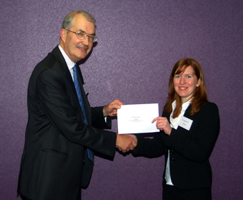 Photo caption: Julia Krier is presented with her award by Peter Hannam, President of Yorkshire Law Society
