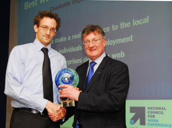 Matt Hutchinson, CommIT Project Manager, LUVU, receiving the award from David Frost, Director General of the British Chambers of Commerce