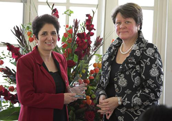 Professor Farideh Honary receiving Lancaster's bronze award from Julie Ashdown