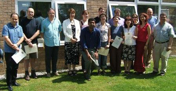 Teachers with their certificates