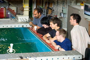 School children In the Engineering Department, pupils were given the task of designing and testing a floating device which would support a glass of water in a wave tank